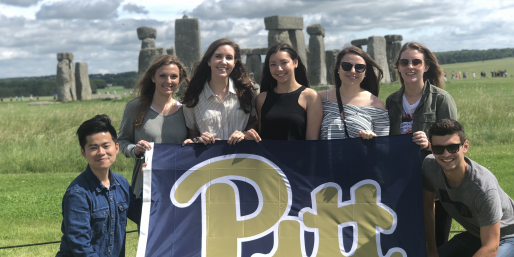 Group of people with a Pitt banner.